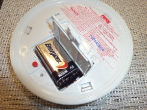 open the latch on your smoke detector, to expose battery. Disconnect and replace battery.