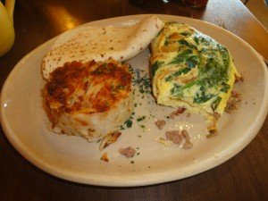 3 egg omelet with sausage, carmelized onions and spinach, hashbrowns and tortilla