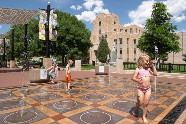 5 reasons to buy now in Boulder photo of children plying in a fountain on Boulder Pearl street mall