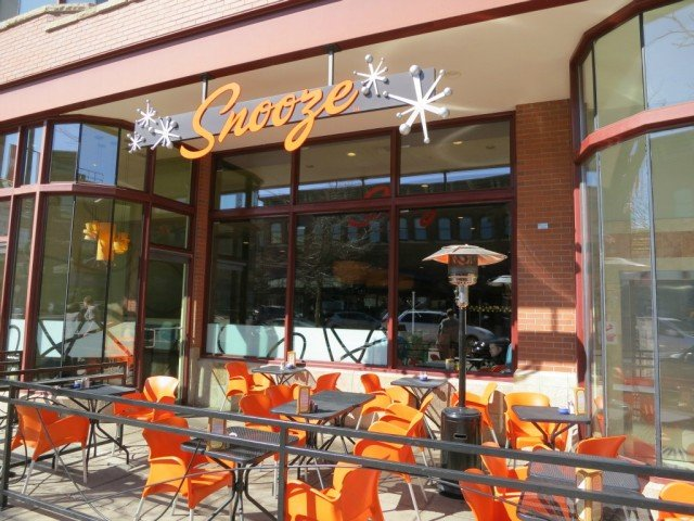 bright yellow and orange seating outdoors at Snooze