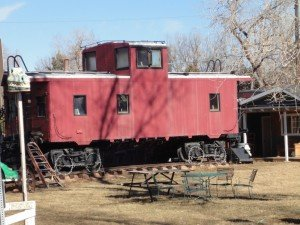 a red caboose in a backyard in Boulder near Baseline and Cherry Vale