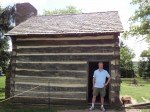 silly photo of Bob, the blogger, in front of a small rustic cabin