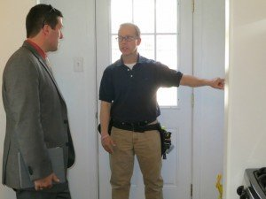 Home Inspection Boulder - Jon in foreground, inspector from Firefly pointing out a feature of concern