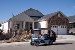 Golf cart in front of home at 14983 Verbena Street Thornton Colorado 80602