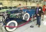 Brian Senjem pictured in front of a classic car in the Stephen Tebo Car Collection
