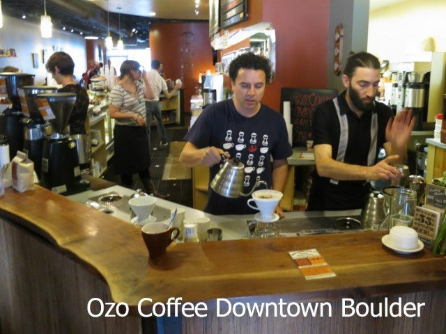 Justin Hartman, pictured on left, is demonstarting the art of coffee at ozo coffee downtown boulder