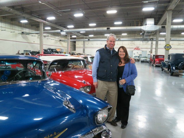 Bob Gordon Realtor berkshire hathaway homeservices and another lady real estate agent in massive garage car collection