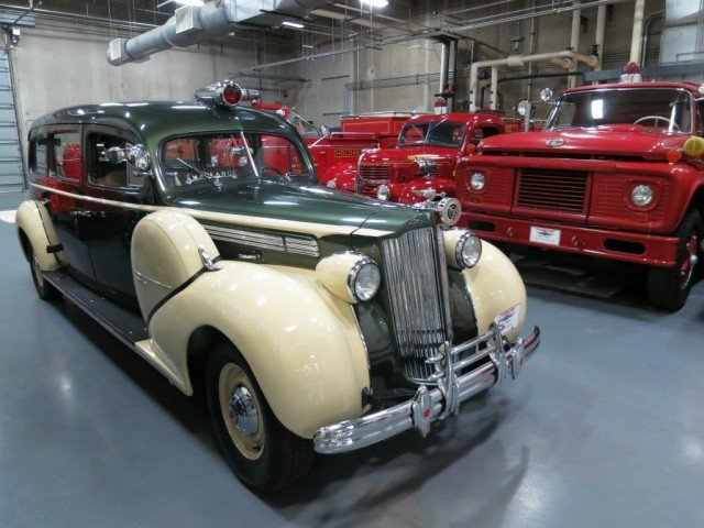 vintage fire trucks and an ambulance in the Tebo car collection
