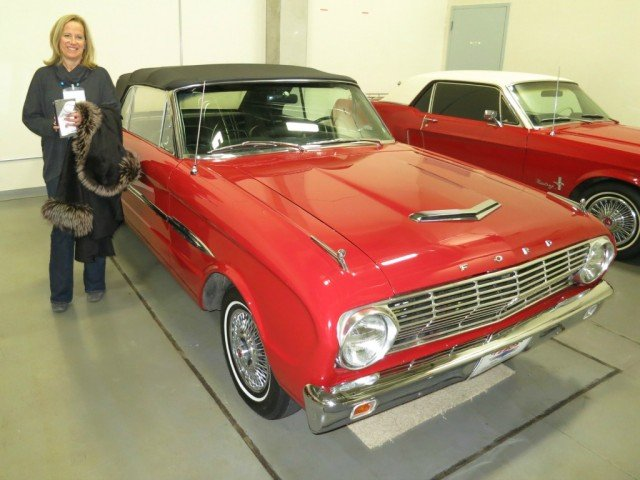 Laura Sparks, a principal in Three Ring Events, poses alongside a beloved Ford Mustang