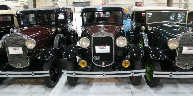 Model A's gleam under the lights at the Tebo car collection in NW Boulder County