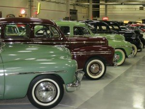 row upon row of gleaming vintage automobiles