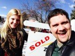 Chris and Megan a few hours before their Boulder real estate closing posing by the SOLD sign