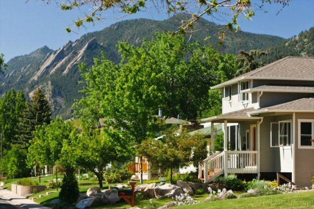 boulder home with mountains
