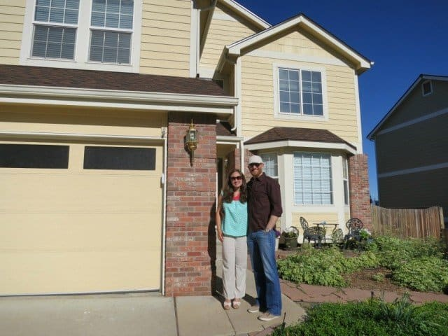 stephanie and josh in front of the home they purchased with Bob Gordon Realtor as their agent