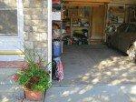 flower basket by garage door is pretty