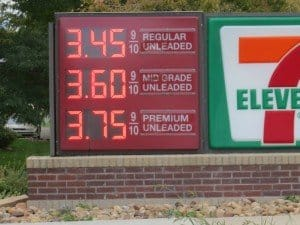 gas price sign with high prices pictured helps explain commute is one of reasons not to becoe a home owner