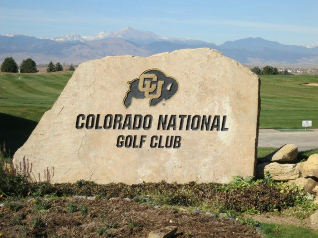 colorado national golf club signage with mountains in the background