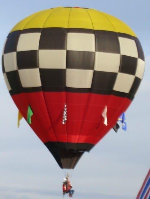 a hot air balloon enthusiast in a minmalist basketless rig