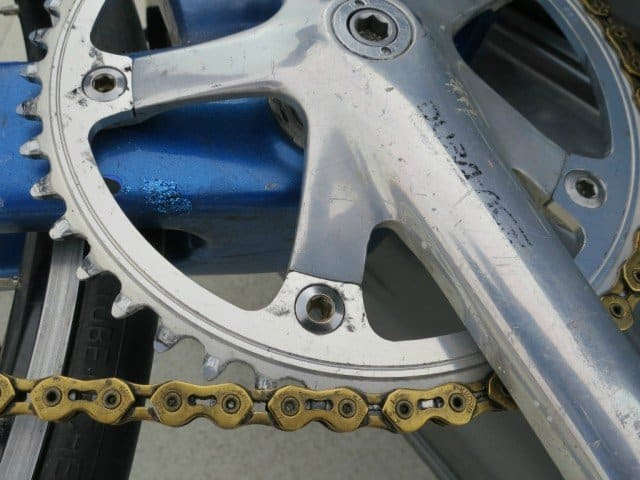 gold chain on bicycle