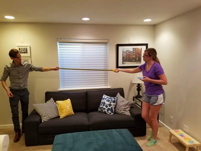 jon leopold and tracey leopold measuring for furniture in their first home