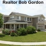 10785 kalispell commerce city from front yard exterior with bob gordon realtor written across top in black type