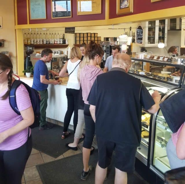 people in line inside the bustling spruce confections downtown coffee shop