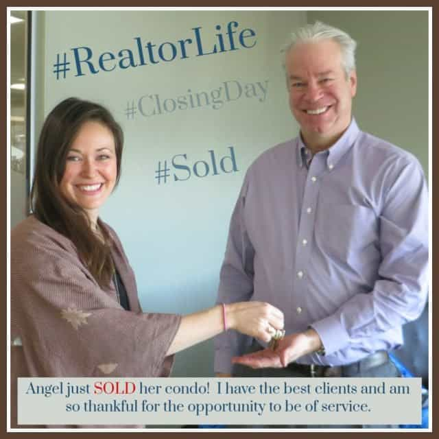 Angel Abston and realtor Bob Gordon exchanging keys to the home at 6640 e mississippi #9 Denver colorado following the closing