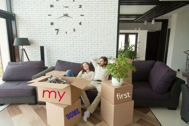 purchased my first home and relaxed on couch with boyfriend before unpacking all boxes