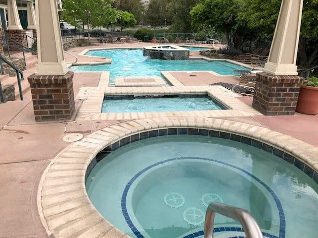 circular hot tub and multi shaped swimming pool at saddlebrooke condo community