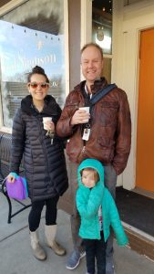 todd and wife and little girl standing in front of east simpson coffee co