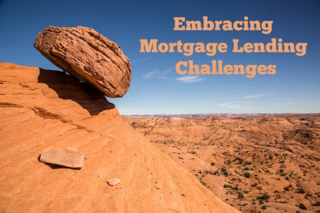 rock precariously balanced on a cliffs edge in the desert and the words embracing mortgage lending challenges