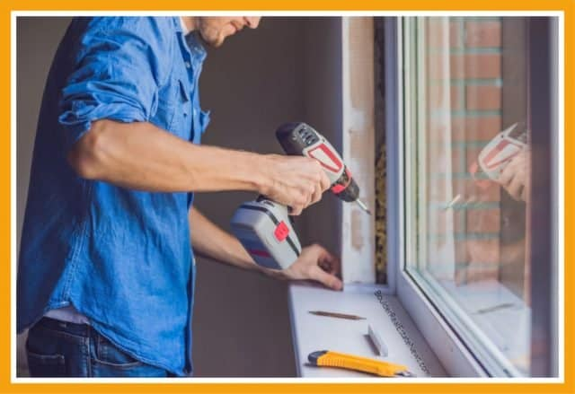 man with drill and in small print along window website boulderrealestatenews