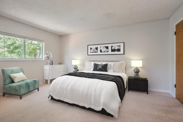 master bedroom in 131 south madison home with a virtual staging of bedroom set including a picture hanging above the bed