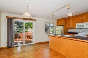 hardwood floors in nook with kitchen and slider