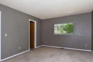 master bedroom on madison with grey walls and doorway to bathroom