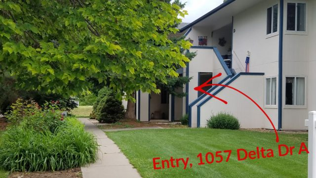 1057 delta dr a looking from the street to condo and there is a red arrow pointing to the area of the front of property
