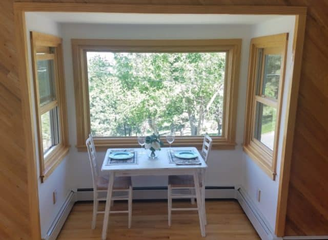 mountain kitchen nook set for two with a picture window looking out on the moutains above boulder colorado