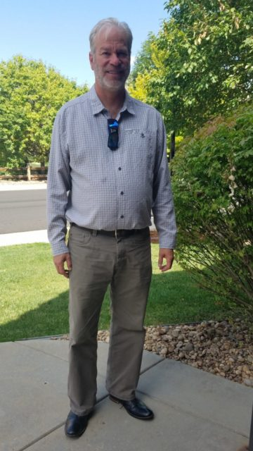 realtor bob gordon pictured in the front walk to 1611 orion place longmont and sporting a beard