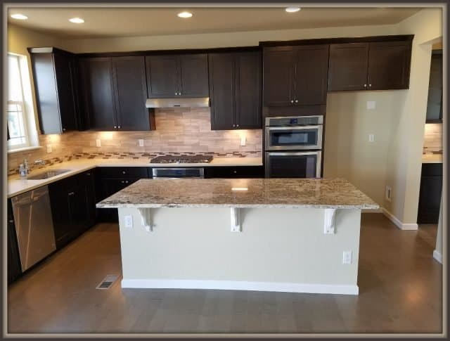 kitchen with granite island but o refrigerator at the trails at coal creek