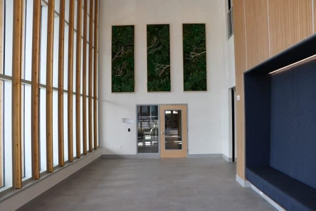 west medical building interior foyer is two stories high with loads of glass and built in seating area