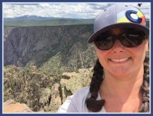 dana briganti loan originator boulder colorado in front of the mountains on a summers day