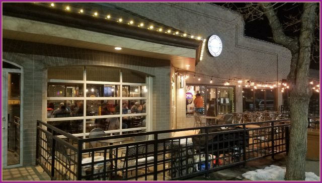front range brewery exterior with outdoor seasonal seating and a lively lafayette crowd visibile through the garage door style windwos