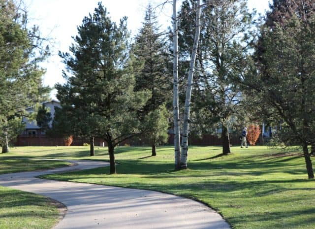 big trees line quiet paths and lush fairways at boulder country club