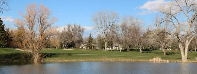 water hazard with golf course in boulder in background including several sand traps to be navigated