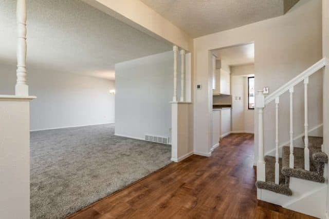 new interior carpets and wood floor transition in house at 7171 s franklin