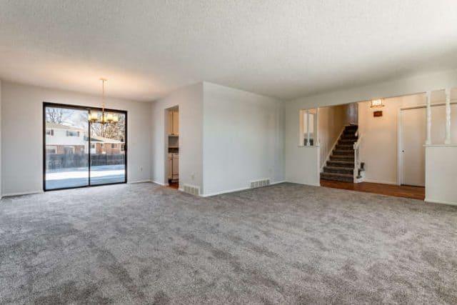 living room to sliding glass door in dining nook