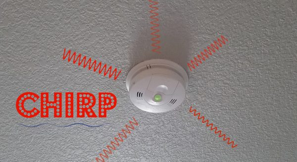 graphic reminder to replace smoke detector batteries annually with chirp sound and waves of sound emanating from smoke detector