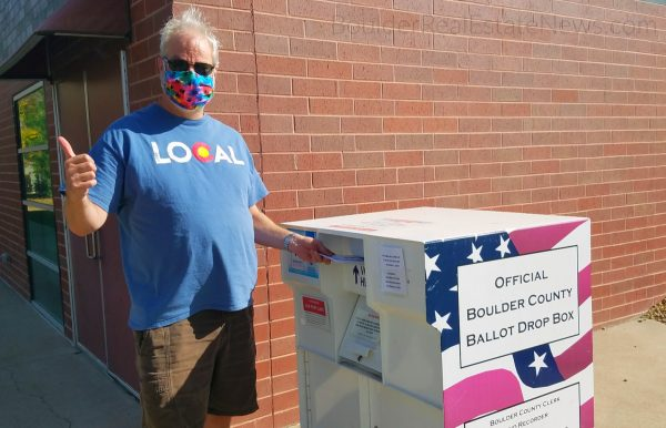 local realtor bob gordon picutured as he drops ballot and get out the vote in 2020
