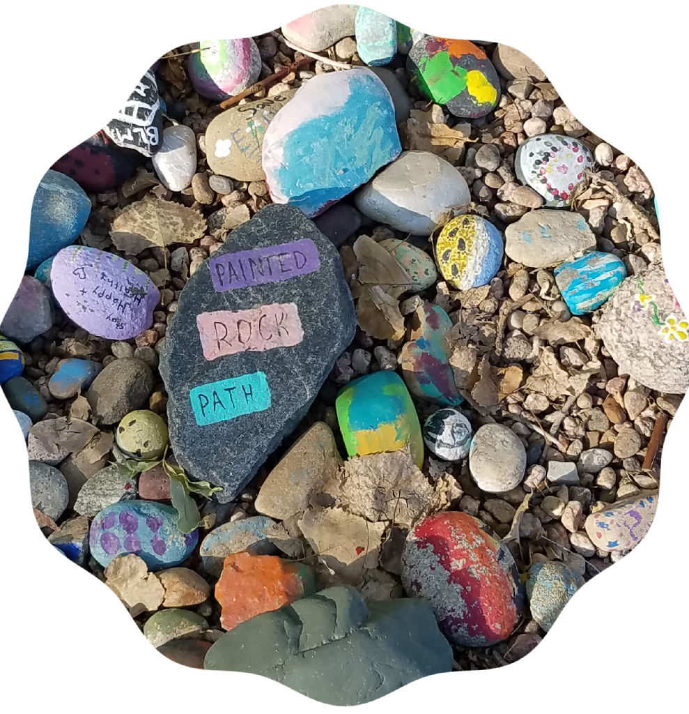 hand painted rocks with messages of hope such as painted rock path and black lives matter initials