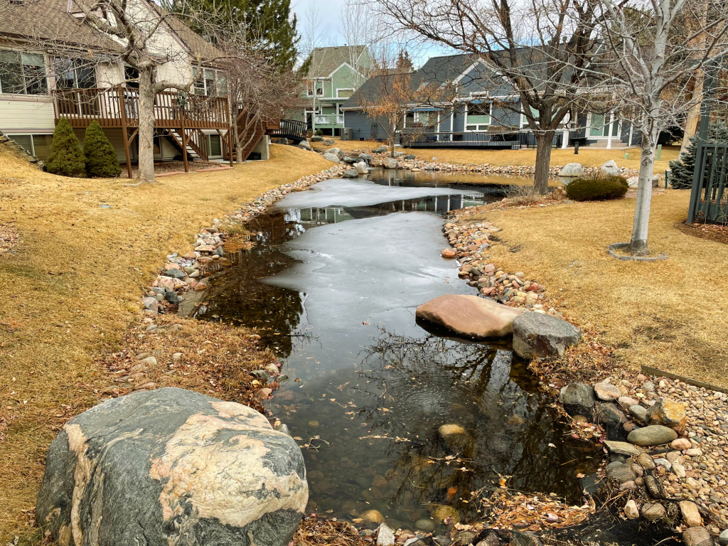 coal creek golf course water feature pond with homes surrounding